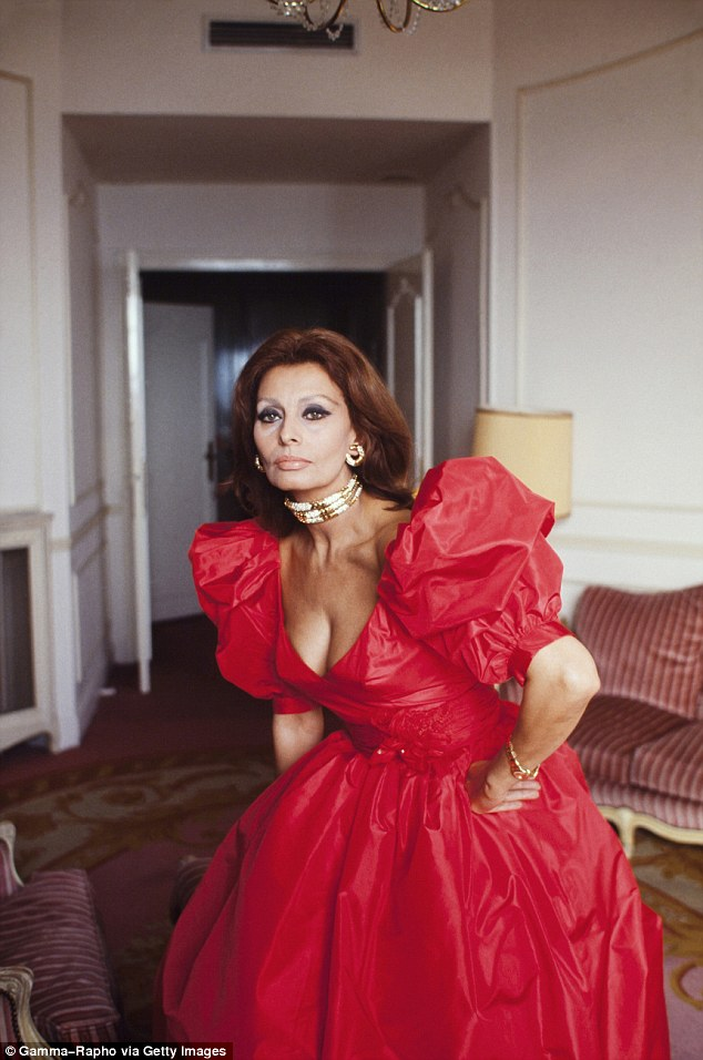 What a frill: The Italian actress was pictured in a hotel room in a cocktail gown in a nostalgic image