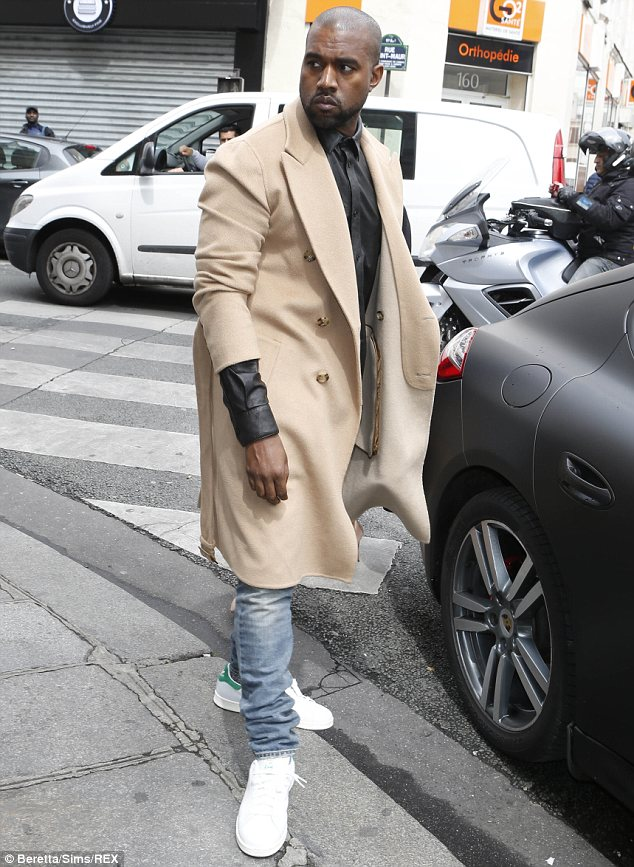 Sharp eye: Mr West, who was out to lunch in Paris at the time (pictured) had been asked by the fan to sign the sneakers and Mr West obliged despite the fact they were counterfeit
