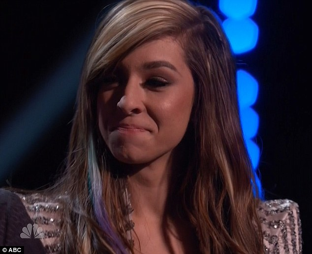 Smiling through the heartbreak: Hopefully loser Christina Grimmie was not taken in by mentor Adam Levine's boast she was sure to win the title