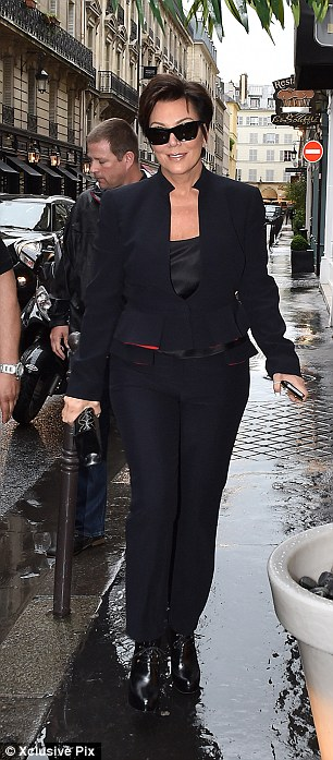 Proud mama: Kris Jenner looked chic in her preferred all-black ensemble while her own mother was also effortlessly stylish with a white coat