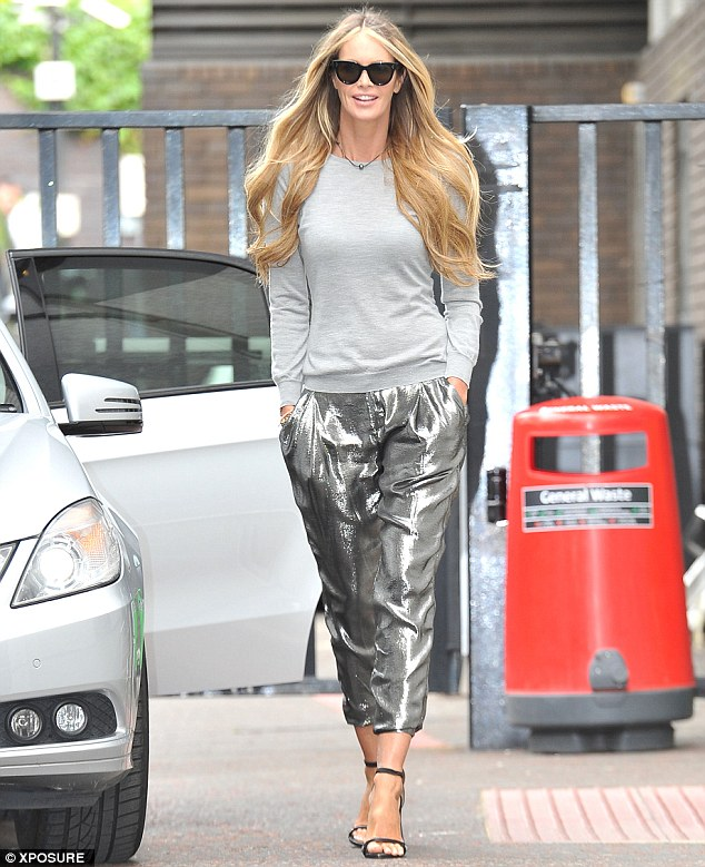 Car park perfection: Elle Macpherson looked incredible as she arrived at Lorraine on Wednesday morning