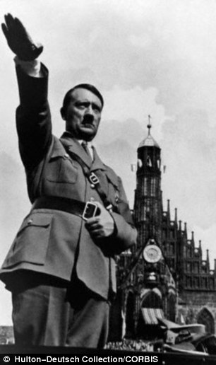 Controversial: Hitler gives the Nazi salute in 1934. A court in Switzerland has ruled that the gesture is not illegal if intended as a personal statement