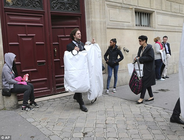 Bags to go: A team of people have been busy getting the preparations ready for Kimye's pre-wedding festivities
