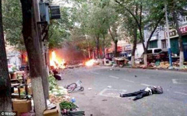 A picture allegedly from the bomb site, shows a man lying on the street after explosions rocked through Urumqi in China's north-west