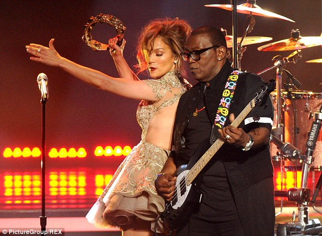 Playing her instrument: J-Lo got struck into her performance and tambourine playing