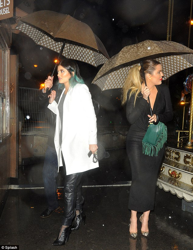 What IS this? As Aneglinos born and bred, Kylie and Khloe are not used to wet weather