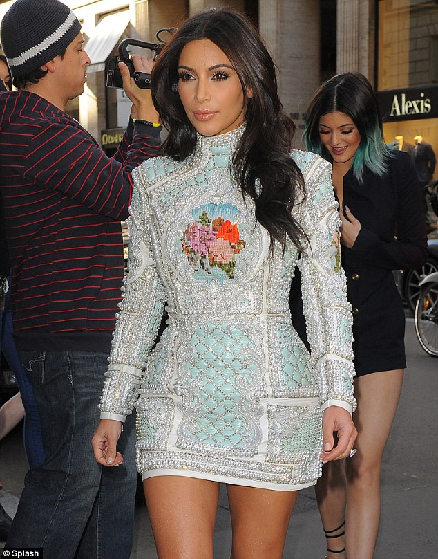 Fit for a queen: Kim smiles as Kylie follows her into the party