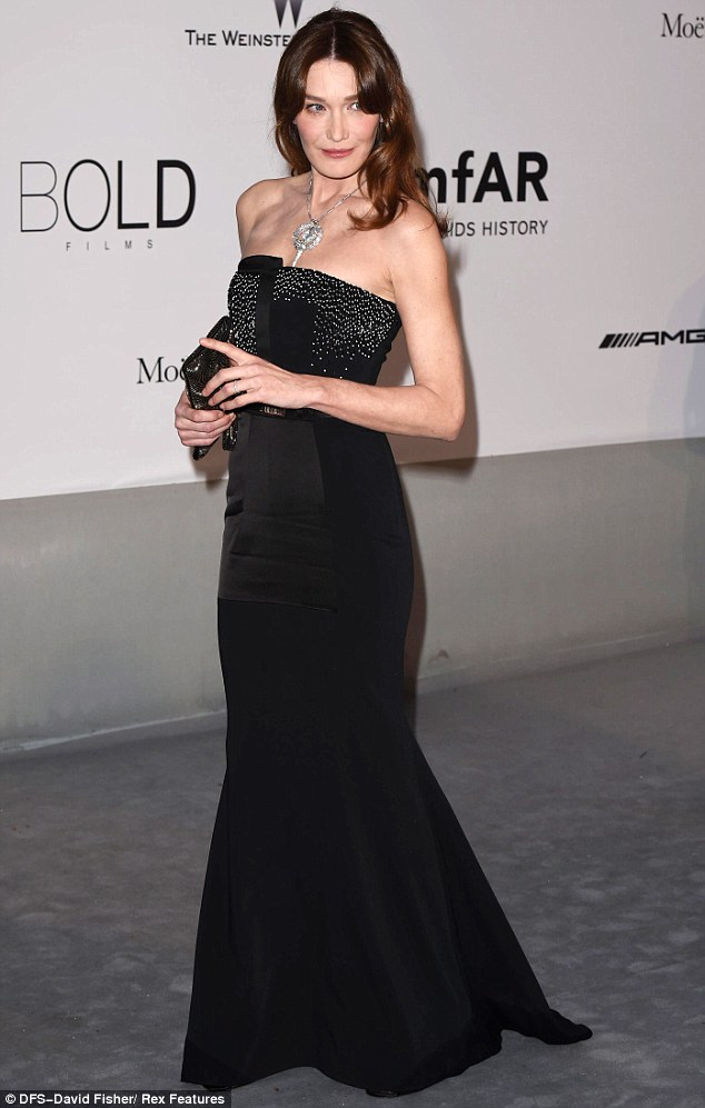 Class act: Former First Lady Of France Carla Bruni-Sarkozy captivated in a strapless gown with embellished bodice and trumpet skirt