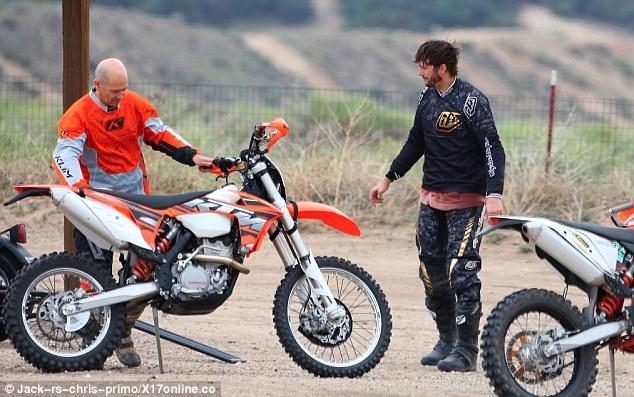Getting ready to go: Ashton prepares to hop on to his Motocross bike