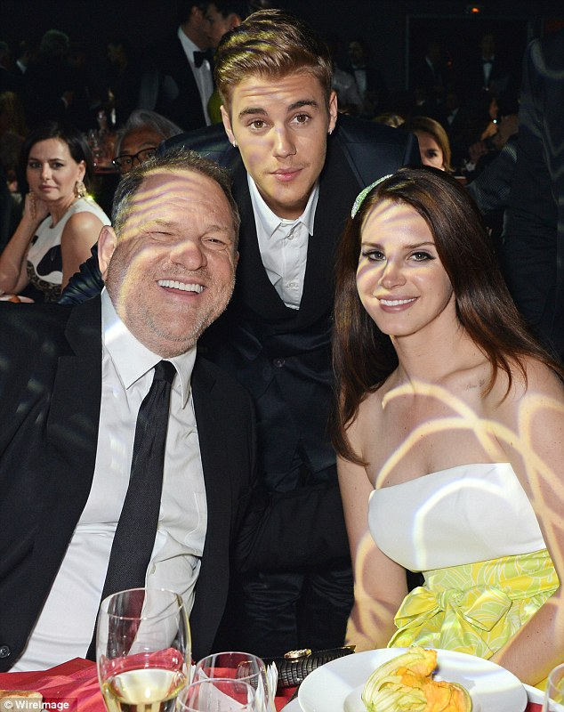 Schoozing: Justin Bieber posed with Harvey Weinstein and Lana Del Rey at the amfAR gala at Hotel du Cap, Cap d'Antibes, France, on Thursday. While guests waited for the banquet, Justin ate pasta off the children's menu