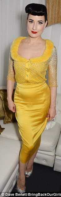 Stylish: Also celebrating were Dita Von Teese in yellow, Lady Victoria Hervey in orange, and the English model in a sheer black jumpsuit
