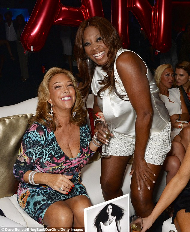 Throwing shade? Austrian singer Denise Rich shared a feisty laugh with presenter Star Jones as two women whispered in the background
