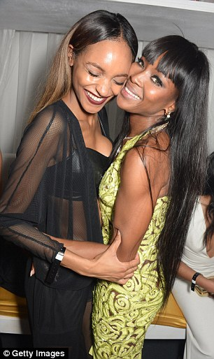 Affectionate: The birthday girl also wrapped her arms around 23-year-old model Jourdan Dunn