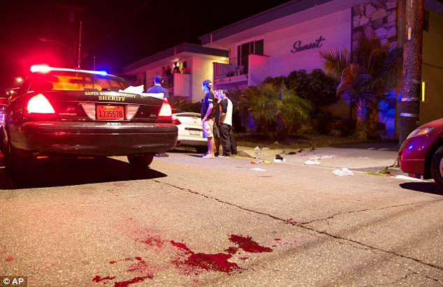 College terror: Police investigate the bloody scene of a drive-by shooting in a Santa Barbara enclave that is home to many students