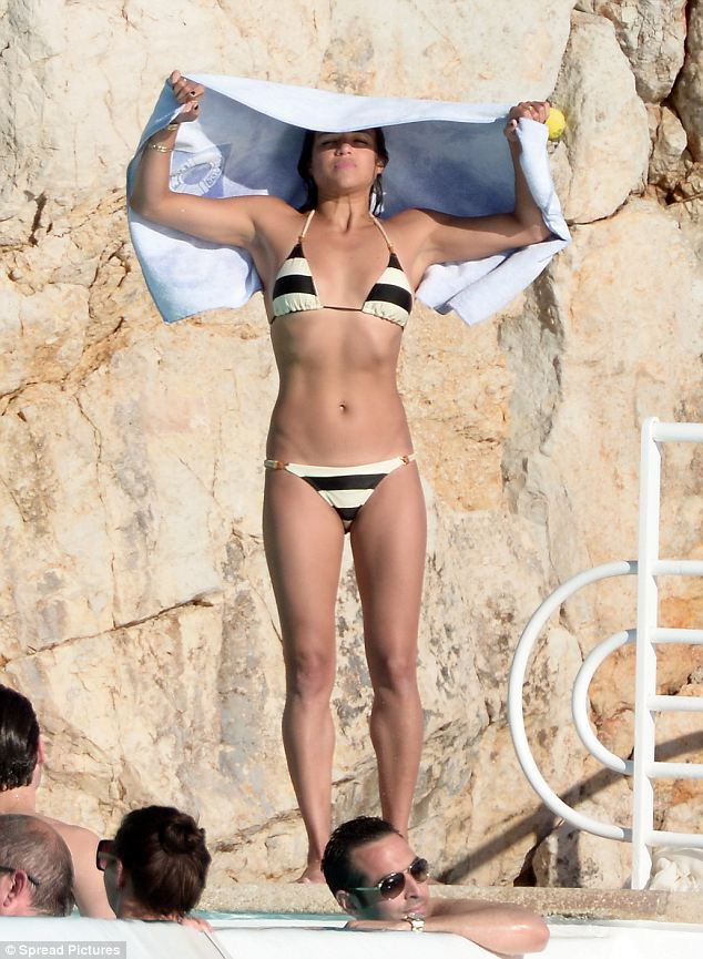 Looking good: Michelle Rodriguez shows of her incredible body on a tiny sexy striped bikini while enjoying the sun at Eden Roc