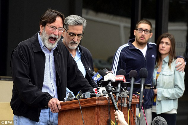 Distraught: Richard Martinez (left), the father of  mass shooting victim Christopher Martinez, expresses his anger and sorrow as he speaks to the media with his brother, Alain (second left) by his side outside the Santa Barbara County Sheriffs headquarters in Goleta, California