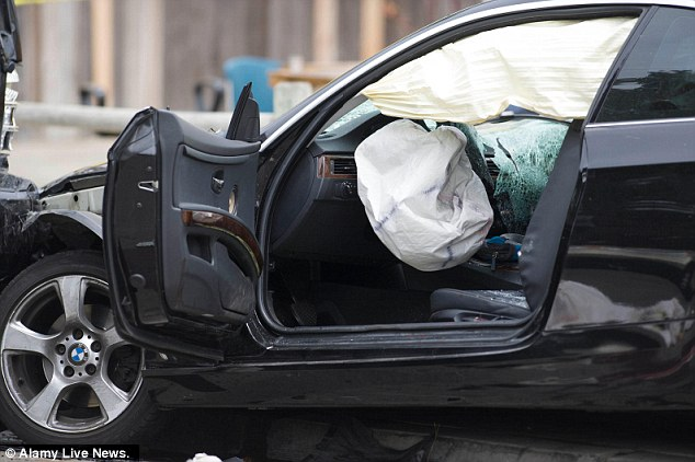 End of the road:  The shooter's crashed car is seen from the driver's side, where Elliot Rodger ended his life with a bullet to the head
