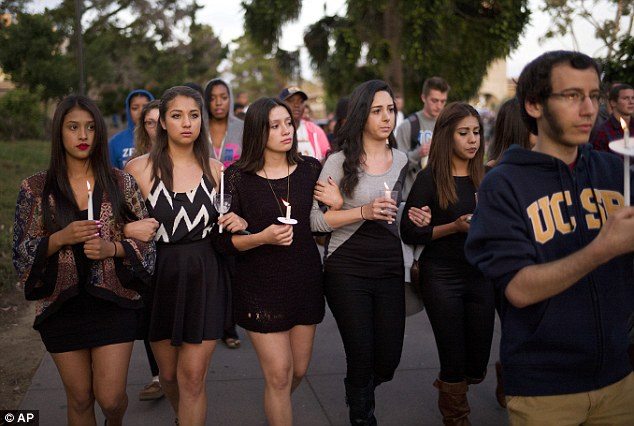 Hand in hand: UCSB students march on the campus in honor of the six victims of the massacre