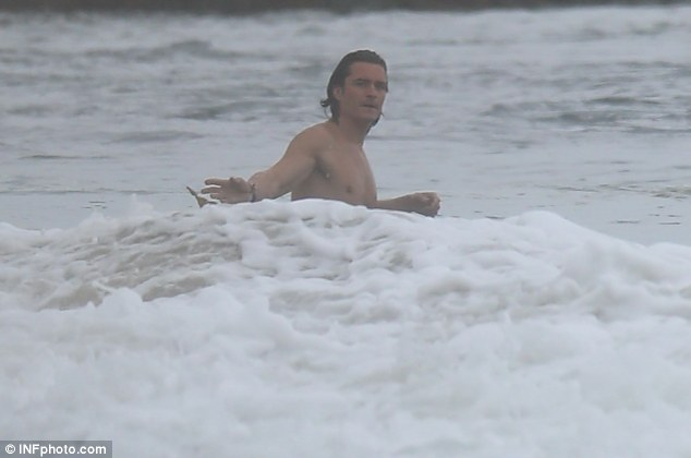 Father-son-day: Flynn stayed on the beach while his father played in the waves on the beach in Malibu