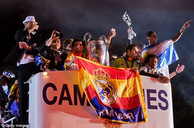Champions: The Madrid players flew back and celebrate with fans in the Spanish capital in the early hours