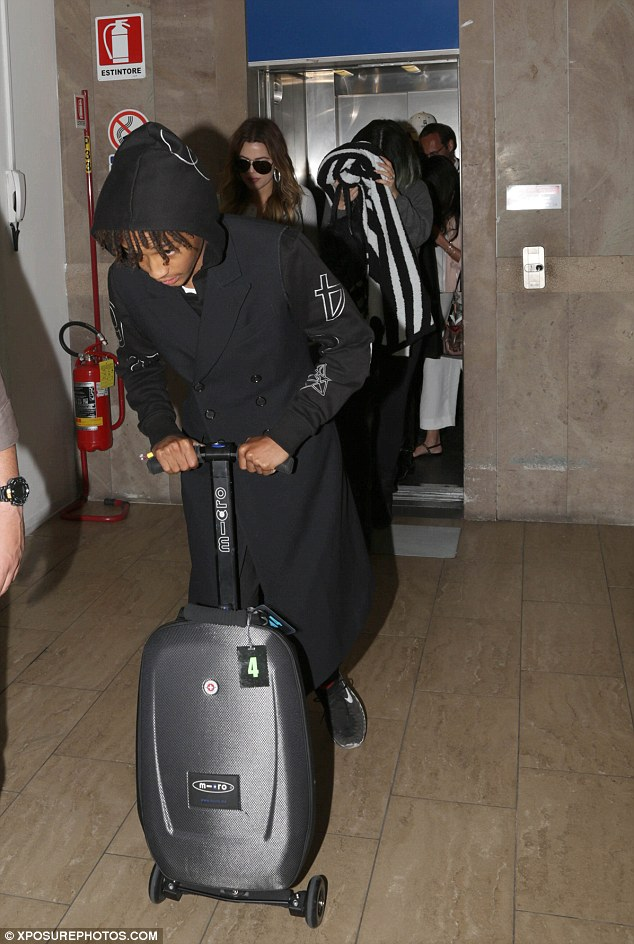 Special guest: Will Smith's son Jaden was pictured wheeling his hand luggage through the terminal