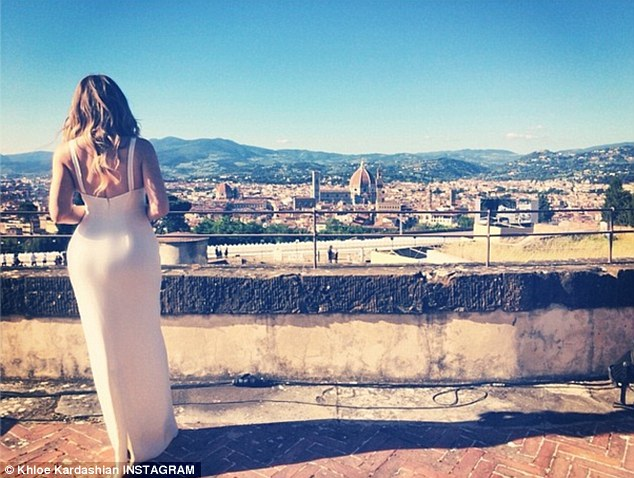 'And they lived happily ever after': Khloe Kardashian shared this Instagram photo of herself overlooking Florence where her sister Kim Kardashian married Kanye West on Saturday, looking lonely in her stunning bridesmaids dress