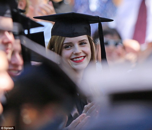 Star appeal: The star enjoyed a laugh and a joke with her fellow graduates during the ceremony
