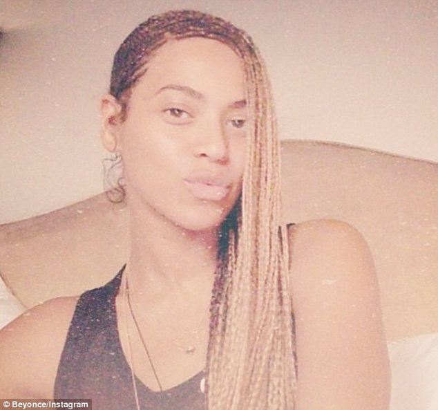 Natural beauty: Beyonce shared this make-up free photo on Instagram as Kim Kardashian and Kanye West's wedding got underway on Saturday