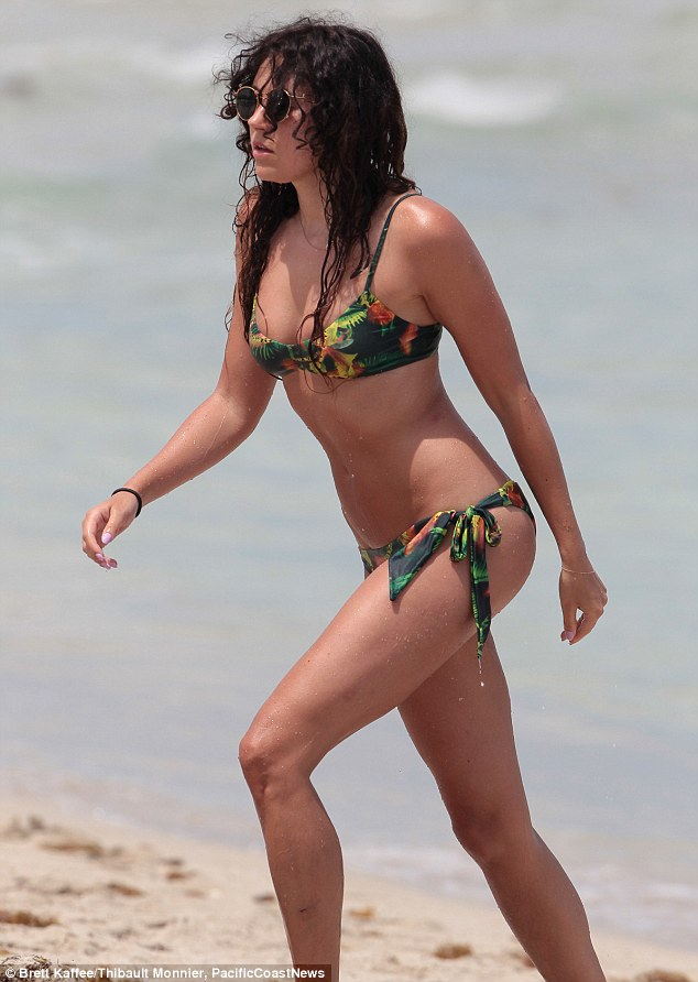 I'm in Miami! Eliza Doolitte showed off her statuesque physique in a tropical-themed bikini while in Miami on Tuesday