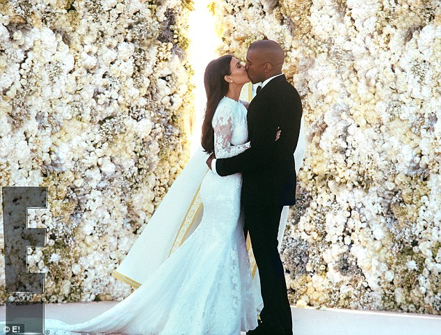 First kiss as man and wife: With eyes from every corner of the globe on her, contouring queen Kim made sure she was picture perfect with a little help from Mario