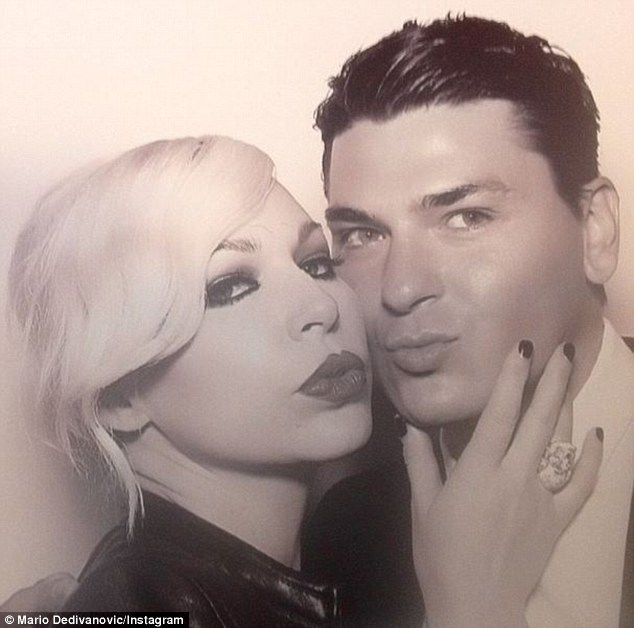 Glam squad: It's unknown whether Kim's best friend and her other make-up artist Joyce Bonelli played any part in her wedding make-up. The pretty blonde pouted alongside Mario in Kimye's wedding photo-booth in Italy on Saturday