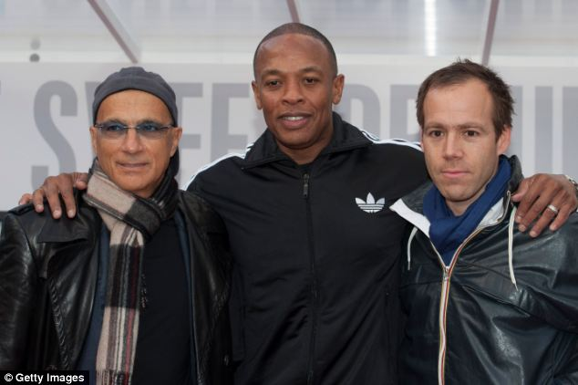 (L-R) Jimmy Lovine, Dr Dre and Luke Wood of beats, which is set to be bought by Apple for $3bn if the firm's biggest ever acquisition.