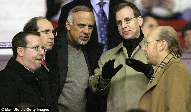 Getting the Glazers in: Avram (right), Bryan (left) and Joel (second left) at Old Trafford just after the 2005 takeover