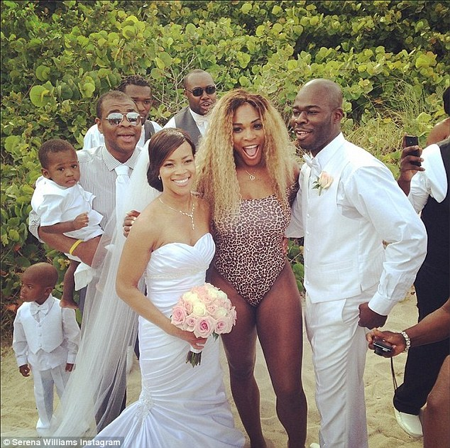 Wedding crasher: Serena Williams found herself crashing a wedding on the beach while clad in a leopard print leotard that highlighted her curvaceous figure