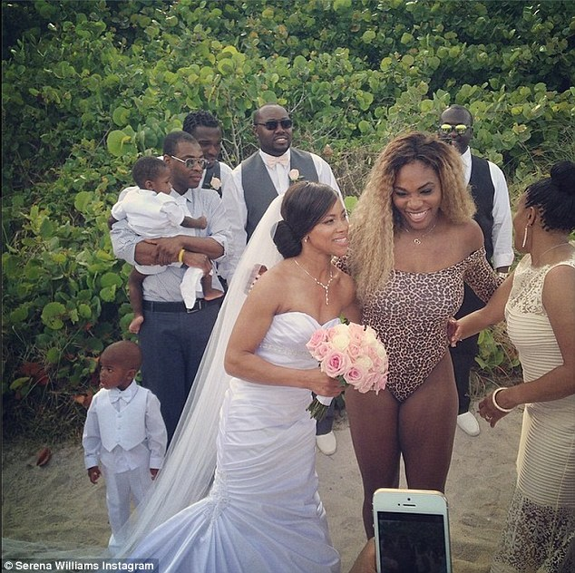 Naughty: The 32-year-old tennis superstar posed with the bride in a snap captioned, 'Bikini wedding crasher!'