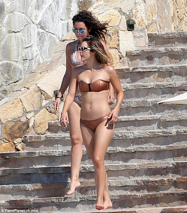 Bronze: The colour of her bikini worked perfectly alongside her tanned skin