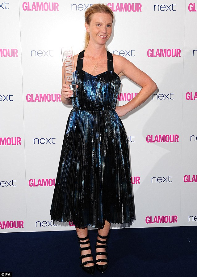Dazzling: Katie Hillier with the Accessories Designer Award, looking rather shiny in her blue pleated dress