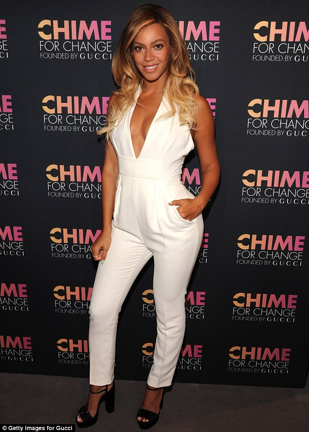 Playful: Queen Bey posed with a hand in a pocket, making use of her jumpsuit's chic accents