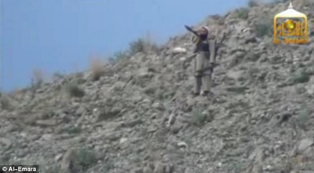 Armed gunmen can be seen standing on the hills around the valley as Black Hawk helicopters draw closer to the meeting point