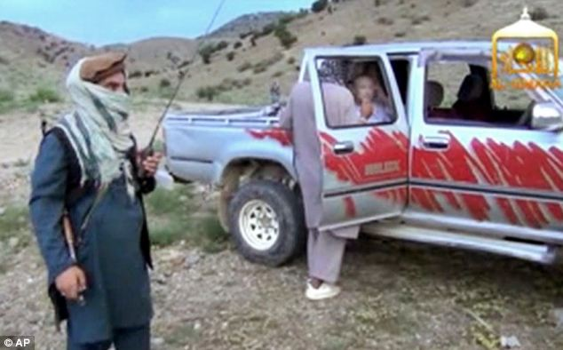 Handover: The Taliban released the video of Bergdahl, who is pictured in the pickup truck