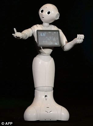 Humanoid robot 'Pepper', equipped with an emotion engine, 'speaks' to introduce itself during a press conference by Japan's mobile carrier SoftBank in Urayasu, suburban Tokyo, on June 5, 2014. Softbank will release the robot nest February with a price of 198,000 yen (USD 1,980).    AFP PHOTO/Toru YAMANAKATORU YAMANAKA/AFP/Getty Images