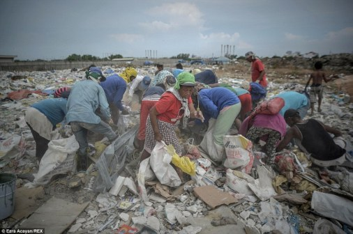 These workers live amid rotting garbage, breathe smoke filled air, wash and cook in polluted water