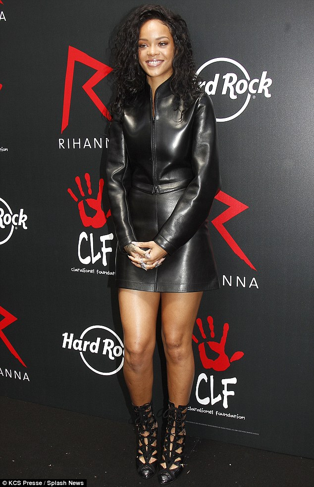 Lady in leather: Rihanna arrives at the Hard Rock Café in Paris on Thursday afternoon