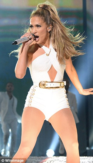 It's all white: J-Lo looked equally splendiferous in this blanched numbe