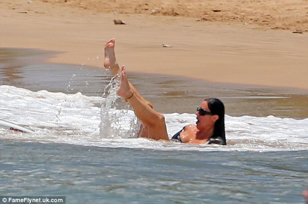 Oops! The TV star tried out a spot of paddleboarding but ended up falling into the sea