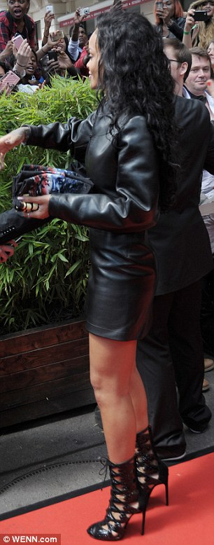 The lady is a vamp: The Bajan beauty looked like the ultimate rock chic in her fierce leather mini and jacket, which she teamed with towering lace-up heels