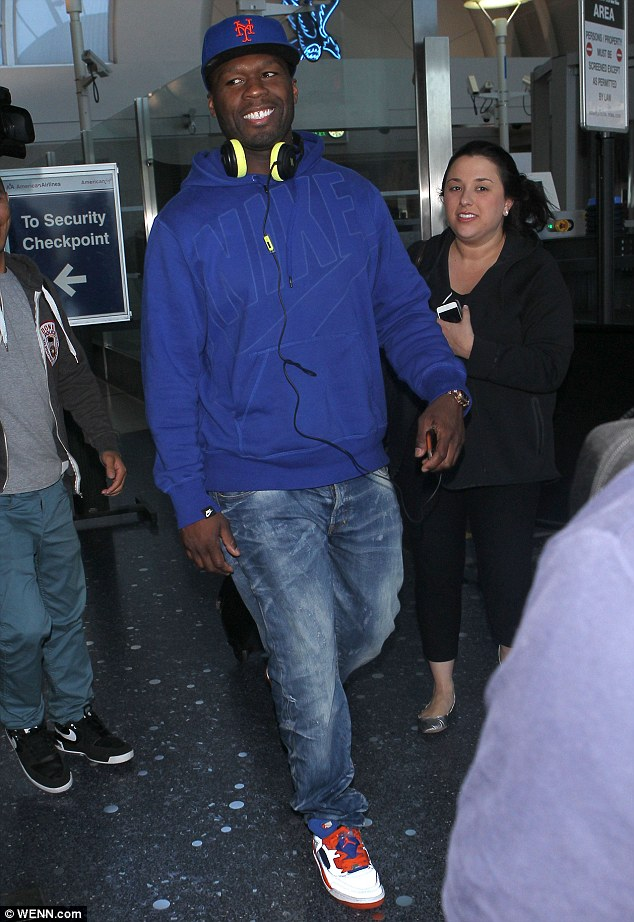 He's no racist: 50 Cent, pictured on Wenesday, insists singer Justin Bieber is 'still a baby'