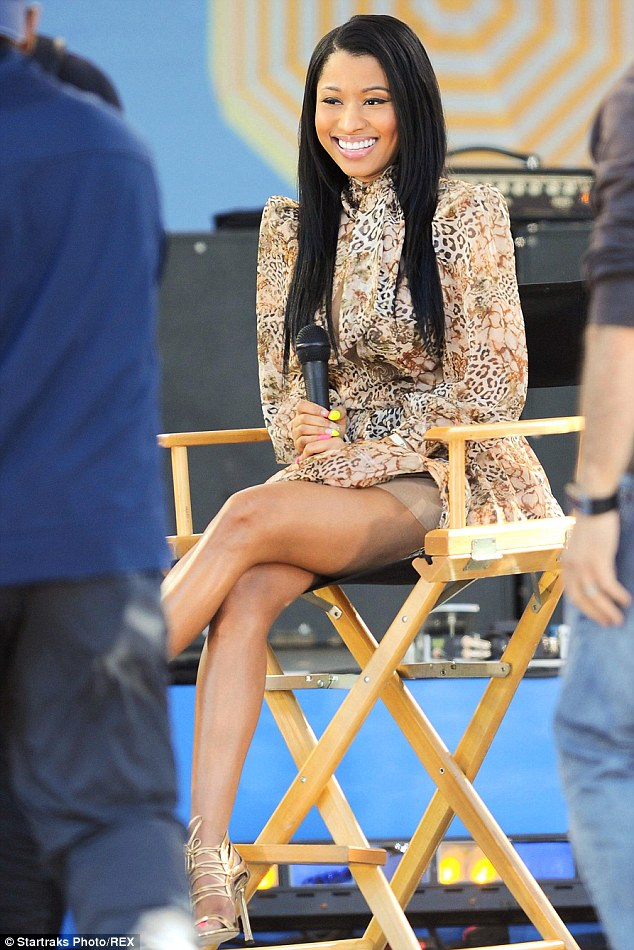 Looking good: Nicki displayed her toned legs in an animal-print frock for an appearance on Good Morning America on Friday