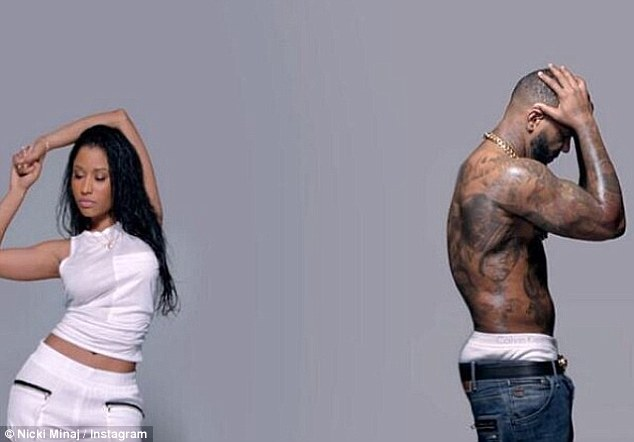 Getting steamy: Nicki Minaj appears alongside a shirtless man in a snippet from her new music video for Pill N Potions released Friday