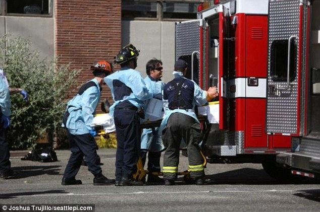 Tragedy: A victim is loaded into an ambulance on the campus of Seattle Pacific University after a shooting Thursday afternoon